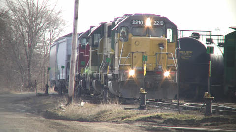 Freight train slowly moves down tracks (High Definition) Stock Video Footage