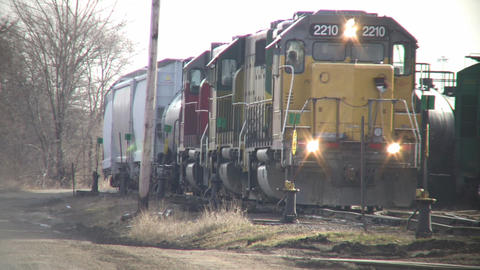 Freight train slowly moves down tracks (High Definition) Footage