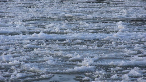 Ice drift in a river at sunset 5 Stock Video Footage