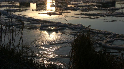 Ice drift in a river at sunset 9 Stock Video Footage
