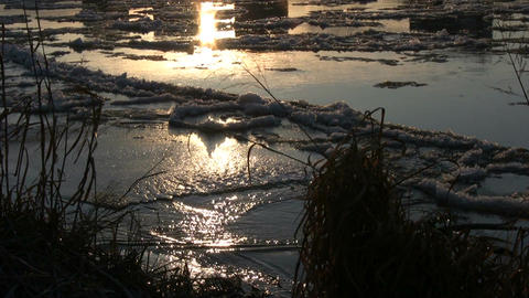 Ice drift in a river at sunset 9 Footage