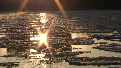 Ice drift in a river at sunset 13 Stock Video Footage