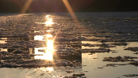 Ice drift in a river at sunset 13 Footage
