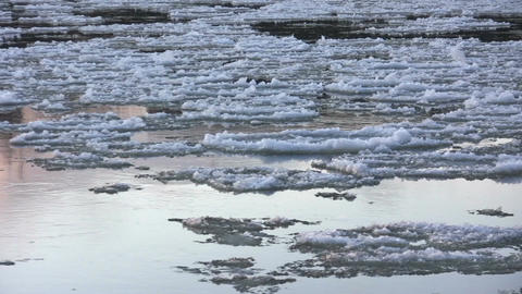 Ice drift in a river at sunset 19 Footage