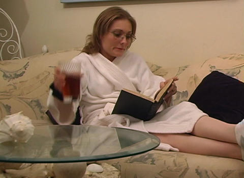 Beautiful Woman Reading at Home Stock Video Footage