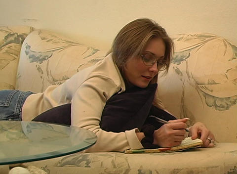 Beautiful Woman Writing (2) Footage