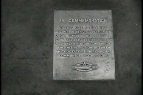 A memorial is held for the soldiers who fought and Footage