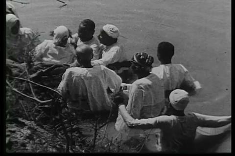 Pilgrims baptize themselves in the Jordan river Footage