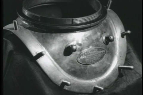 Each piece of antique deep sea diving gear is disc Live Action