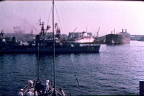 Naval crewmen work onboard their ship during the 1 Live Action