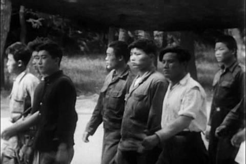 A young Korean man joins the navy during the 1950s Footage