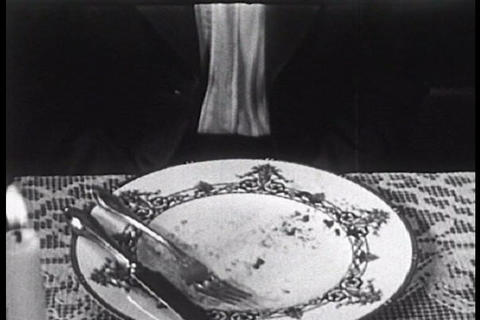 A family eats their Thanksgiving dinner and begins Footage