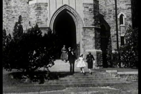 A family leaves a church after service to go home  Footage
