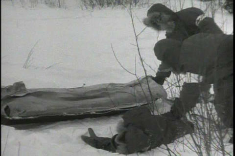 Soldiers stationed in Alaska practice evacuating a Footage