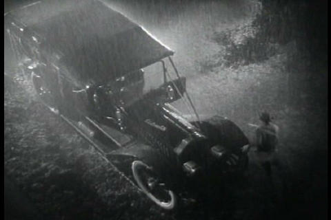 A doctor is taken to a man who had an accident at  Footage