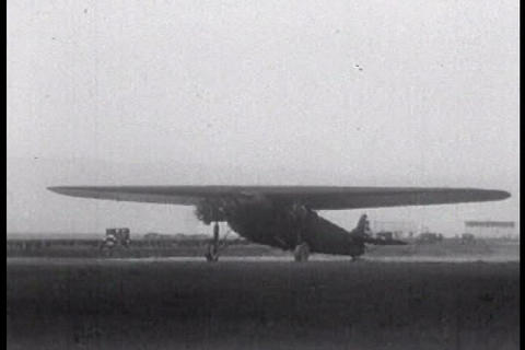 An old 1920s airplane drives on a runway Stock Video Footage