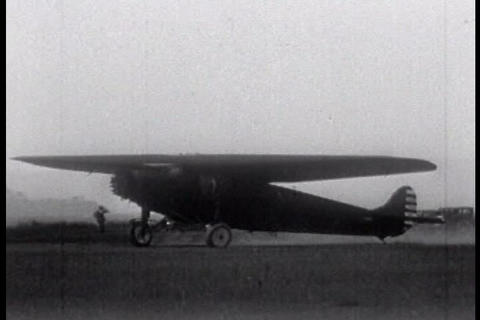 An Old 1920s Airplane Drives On A Runway stock footage