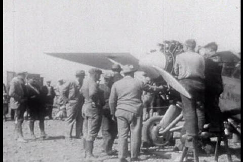 A plane is prepared for flight during the 1920s Footage