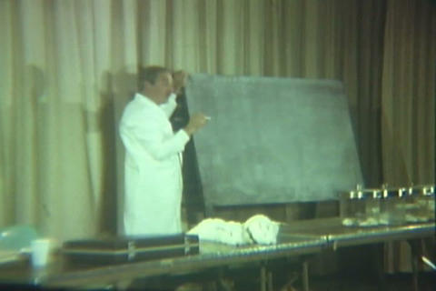 A Doctor Gives A Presentation On The Effects Of Dr stock footage
