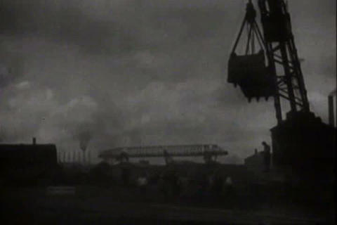 Early demonstration of a steam shovel in an indust Live Action
