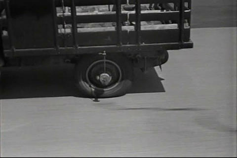 Trucks are tested for tire blowouts in 1937 Footage