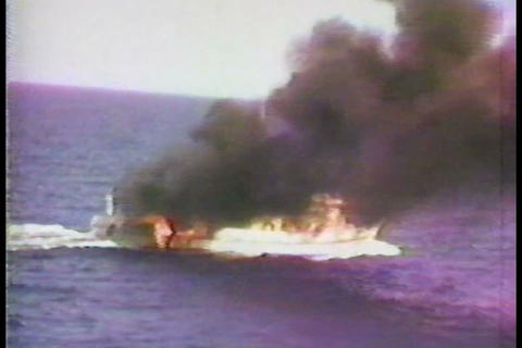 The U.S. Coast Guard Fires At A Drug Running Boat  stock footage