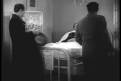 Men Visit A Woman In The Hospital In The 1930s stock footage