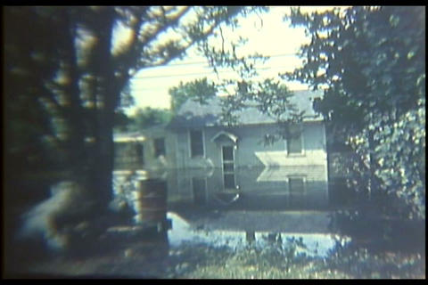 Home movie style footage of flooding in Harrisburg Live Action