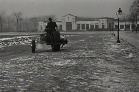 A three wheel vehicle is demonstrated in 1937 Live Action