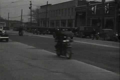 Police cars parade through Detroit in 1932 Footage