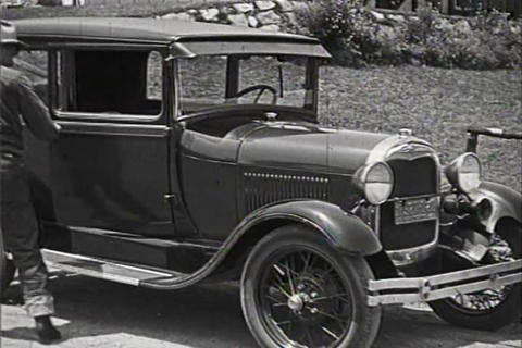 Will Rogers admires the latest Ford cars in 1928 Live Action