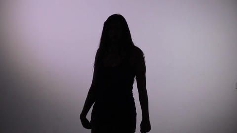 dancing silhouette of girl Stock Video Footage