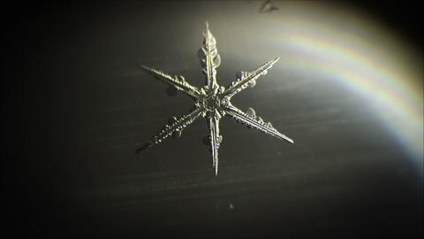 Snowflake appear, micro shot Footage
