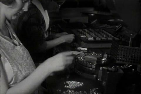 Women work in factories in 1931 Footage