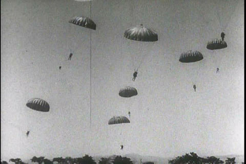 Paratroopers leap from planes during World War Two Footage