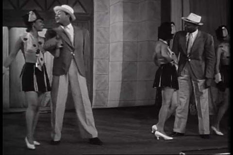 A stage show at a cabaret features dancers and sin Footage