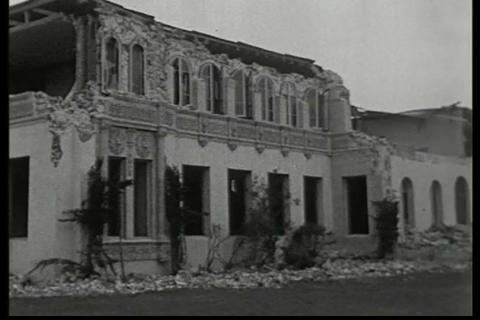 Newsreel footage of the damage from an earthquake  Footage