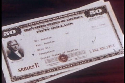 U.S. savings bonds are explained in this 1952 prom Footage