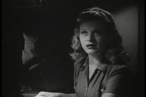 A woman is late to various places in 1944 includin Footage