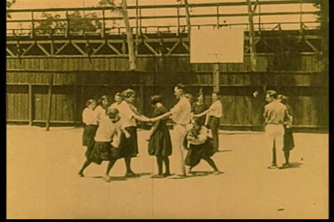 Children play tag in 1928 Footage