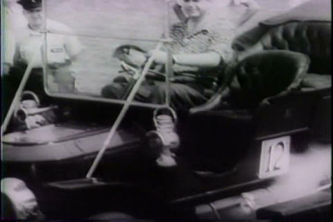 An early car show features old time cars in 1943 Live Action
