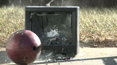 Bowling Ball vs. Television Stock Video Footage