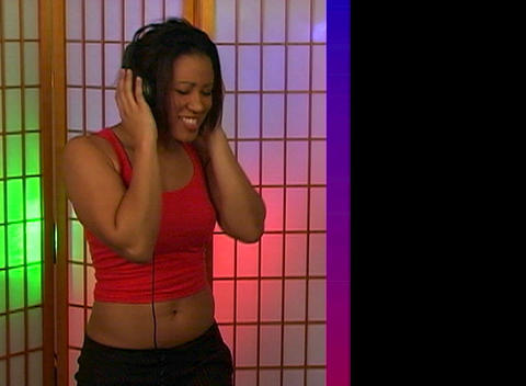 Beautiful Young Woman Dancing with Headphones (2) Stock Video Footage