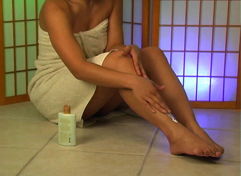 Applying Lotion to Legs (2) Footage