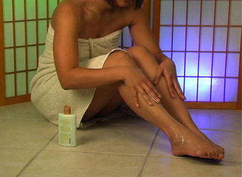 Applying Lotion to Legs (2) Stock Video Footage