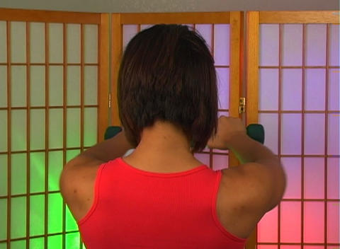 Lovely Young Woman with Hand Weights (7) Stock Video Footage