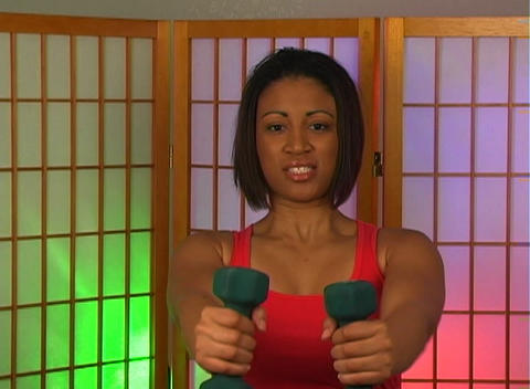 Lovely Young Woman with Hand Weights (9) Stock Video Footage