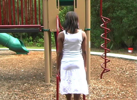 Beautiful Pregnant Woman on a Playground (5) Stock Video Footage