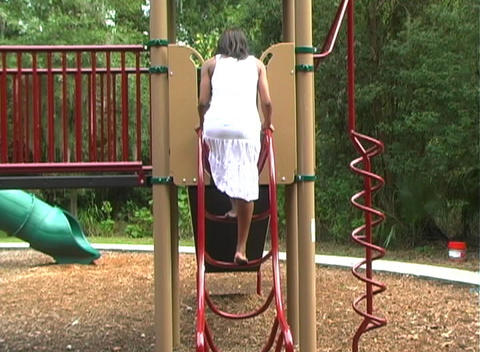 Beautiful Pregnant Woman on a Playground (5) Footage