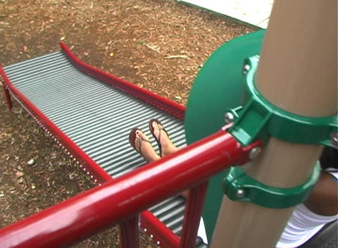 Beautiful Pregnant Woman on a Playground (7) Stock Video Footage